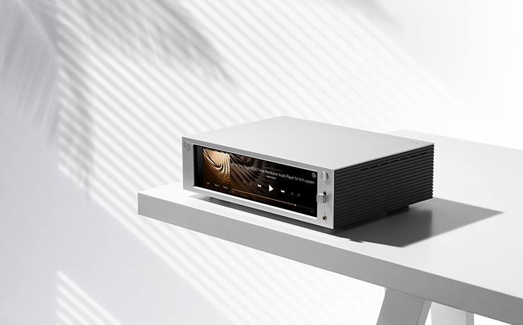 Professional HiFi Media Player RS201E on a table with a pale wall behind