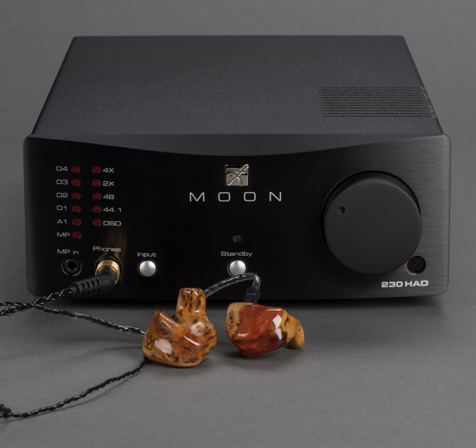 Moon 230HA D Headphone Amplifier with DAC with earphones plugged in.