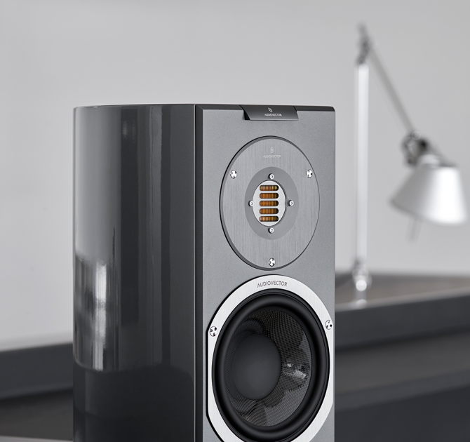 Audiovector R1 Avantgarde in custom grey with a lamp in the background