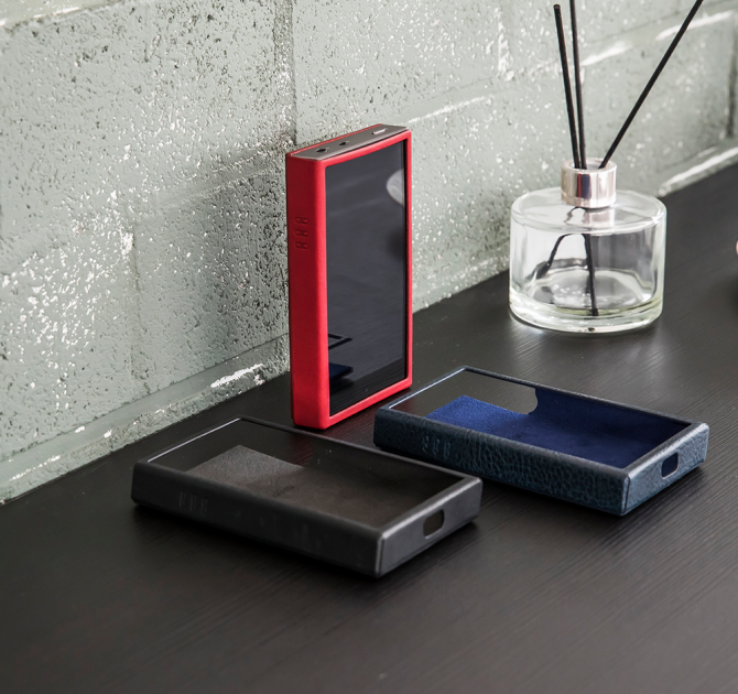 Astell & Kern SE100 Leather Case in red, modern navy and black.