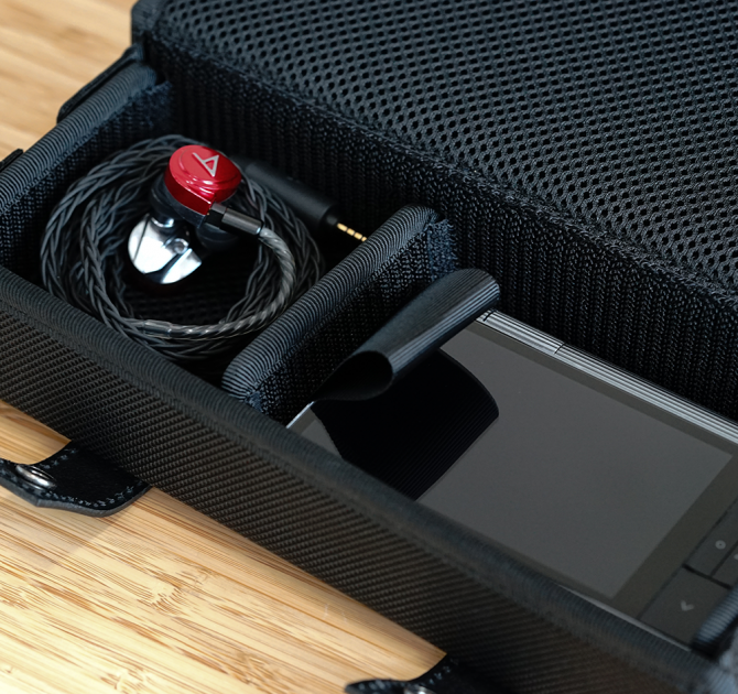 Astell & Kern Van Nuys Case (2-Split) with player and earphones.