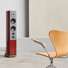 Audiovector R6 Signature in front of a wooden chair