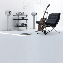 Eclipse TD712zMK2 Speaker on Stand (Single) in silver with a hifi system on shelves, a chair and a guitar.