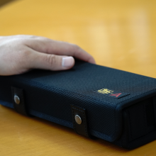Astell & Kern Van Nuys Case (2-Split) case with a hand for scale.